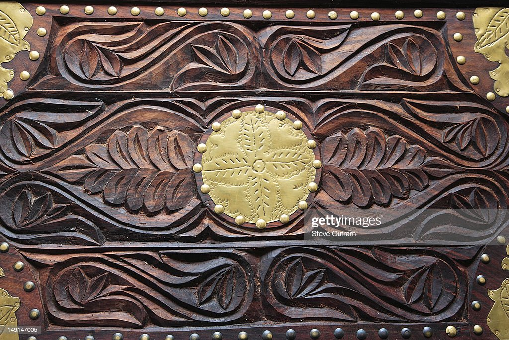 Antique wooden carved chest, inlaid with brass. : Stock Photo