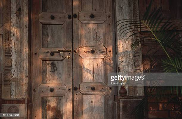 Antique wooden doors salvaged from an traditional Keralan house and used to build the guest rooms at Somatheeram Ayurvedic Beach Resort