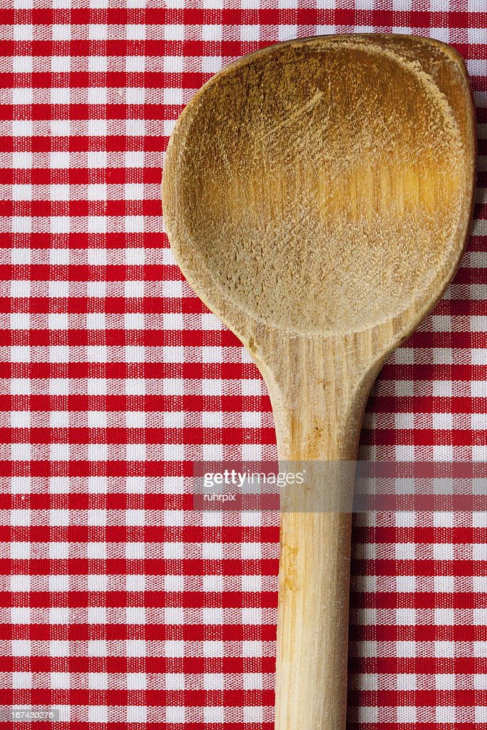 Antique wooden spoon for cooking with red white background : Stock Photo