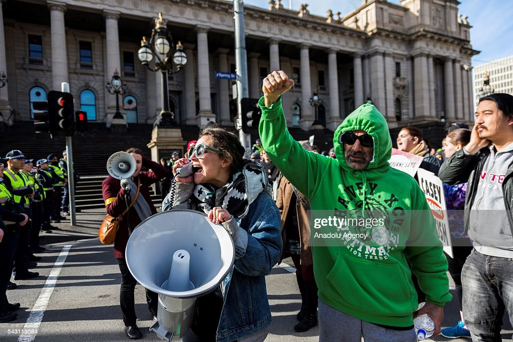 Anti-Racism protestors shout and chant slogans in front of police during a protest organized by the anti-Islam True Blue Crew supported by the United Patriots Front in Melbourne, Australia on June 26, 2016.