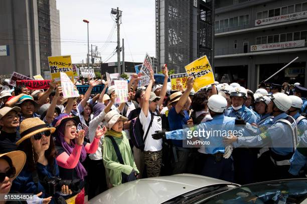 Antiracist groups tried to block Japanese nationalists from marching on the street during a counterprotest rally demanding an end to hate speech in...