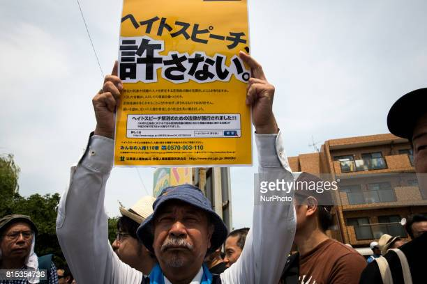 Antiracist man holds a banner during a counterprotest rally against quothate speechquot rally in Nakahara Kawasaki City Kanagawa prefecture Japan on...