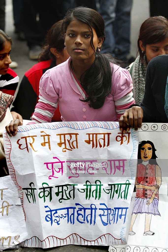 Anti-Rape protesters holding placards during gathering to mourn the death of Rape victim girl at Jantar Mantar on December 29, 2012 in New Delhi, India. The nation was shocked in the morning after news of her death at the Singapore's Mount Elizabeth Hospital, where she was undergoing treatment. The Gang-rape of 23 year old girl in a moving bus enraged the entire country and galvanized people to demand for protection for women and justice for victims of such heinous crimes. There was heavy security deployment all around the city as many roads were blocked and metro stations were closed down to prevent any untoward incident.