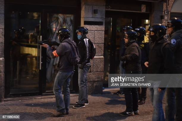 Antiriot police aim at antifascist demonstrators during clashes in Nantes western France on April 23 2017 following the announcement of the results...