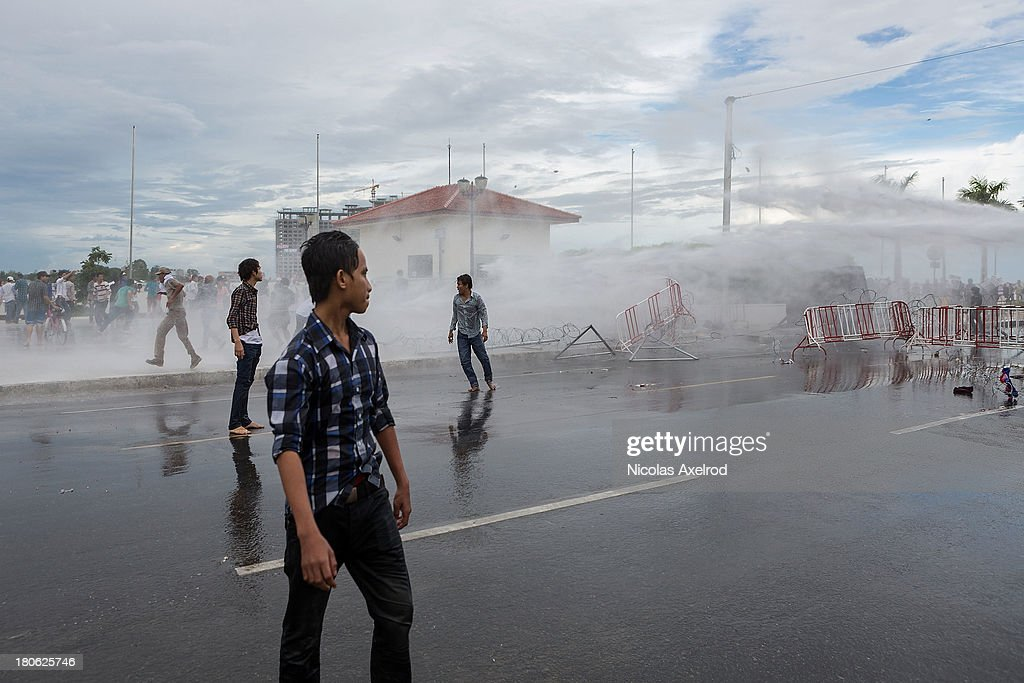 Anti-riot police fire water canons as clashes erupt near the riverside on September 15, 2013 in Phnom Penh, Cambodia. The CNRP plan a three day demonstration to contest the Cambodian national election results.