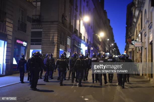 Antiriot police forces patrol the streets of Nantes western France as antifascists demonstrate on April 23 2017 following the announcement of the...