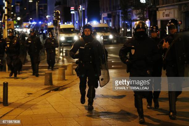Antiriot police forces patrol the streets of Rouen northwestern France on April 23 2017 as antifascist demonstrators protest following the results of...