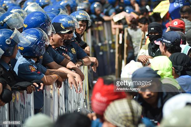 Antiriot police officers have a talk with activists as protesters from various groups attempt to march towards the venue of the Asia Pacific Economic...