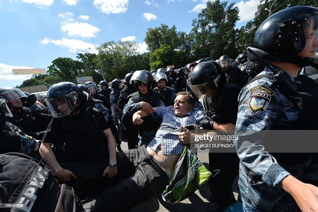 Anti-riot policemen arrest one of the Orthodox believers who clashed with police during a protest to prevent Gay Parade in Kiev on May 25, 2013. Around a hundred gay rights activists marched in Ukraine on Saturday despite fears of violence and a court ban, the post-Soviet country's first ever gay pride event.