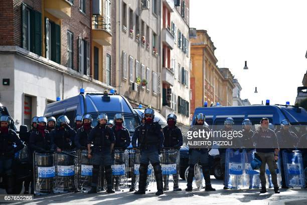 Antiriot policemen block a street during a demonstration against the European Union on March 25 2017 in Rome Italian capital hosts a special summit...
