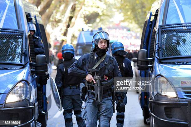 Antiriot policemen patrol during an antiausterity protest on October 19 2013 in Rome Between 3000 and 4000 police officers have been deployed Italian...