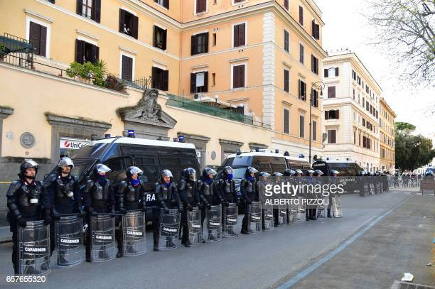 Antiriot policemen stand in front of a bank during a demonstration against the European Union on March 25 2017 in Rome Italian capital hosts a...