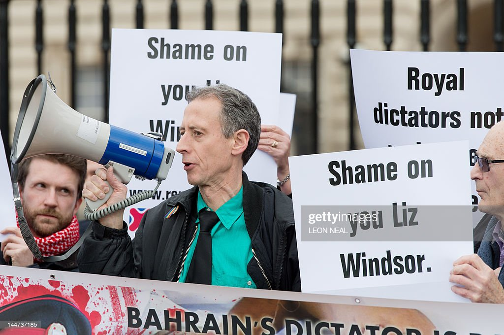 Anti-Royal protesters hold printed messages outside Buckingham Palace in central London on May 18, 2012 to demonstrate against the evening banquet clelebrating Britain's Queen Elizabeth II diamond jubilee where many heads of state are invited. The protest was highlighting the poor human rights records of some of the countries that attended, including Abu Dhabi, Bahrain, Brunei, Kuwait, Qatar, Saudi Arabia and Swaziland.