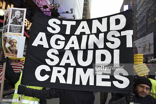 AntiSaudi banner held aloft in Times Square Hundreds of Muslims gathered in Times Square to protest against the Saudi government's execution of...