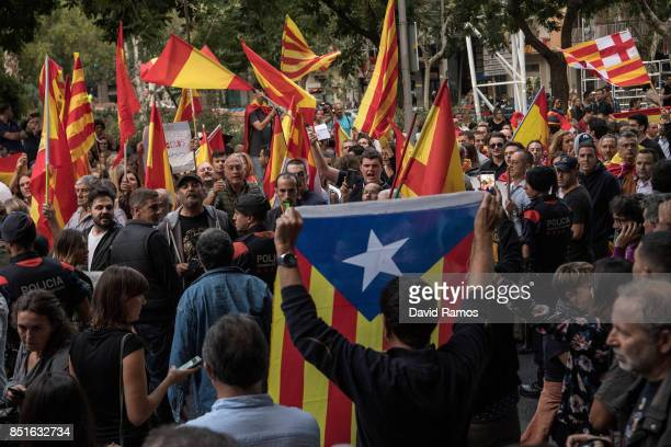 Antiseparatist and Catalan ProIndependence supporters argue during a demonstration called by Spanish far right groups on September 22 2017 in...