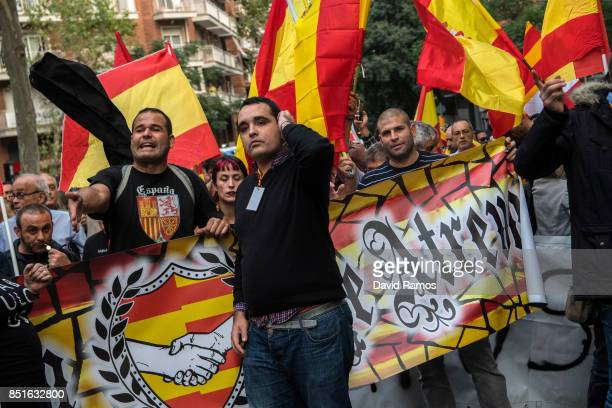 Antiseparatist supporters argue with Catalan ProIndependence supporters during a demonstration called by Spanish far right groups on September 22...