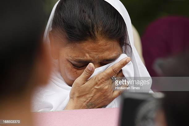 AntiSikh riots victim crying during protest against acquittal of Congress leader Sajjan Kumar in 1984 antiSikh riots case at Rajghat on May 10 2013...