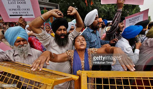 AntiSikh riots victims shout slogans and carrying placards during protest against acquittal of Congress leader Sajjan Kumar in 1984 AntiSikh riots...