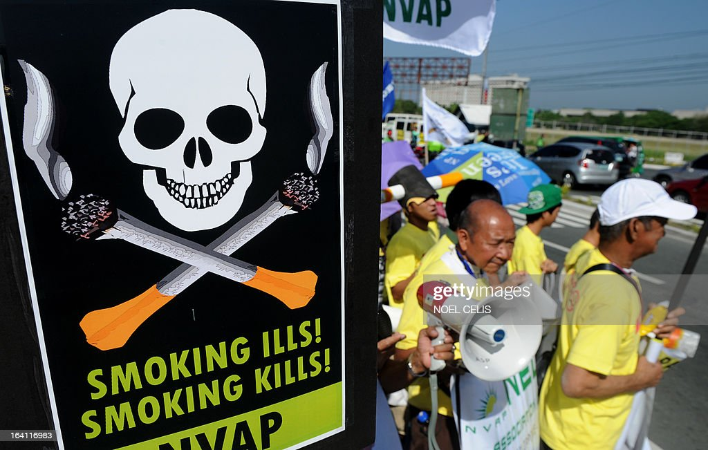 Anti-smoking protesters hold a rally at the entrance gate of the World Trade Center in Manila on March 20, 2013 where the world's biggest tobacco trade show is being held. The United Nations has expressed concern that the Philippines could encourage smoking by hosting one of the world's biggest tobacco trade shows, a health official said on March 20. UN agencies in the Philippines have written to President Benigno Aquino citing Manila's treaty pledge to ban tobacco advertising, promotion and sponsorship, World Health Organisation senior health adviser Eigil Sorensen said.