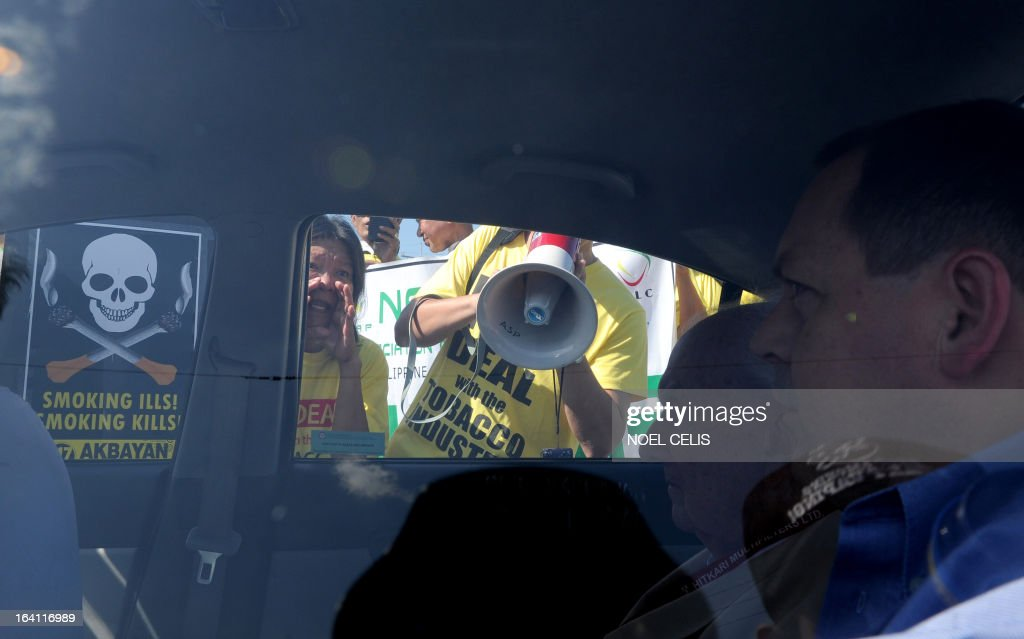 Anti-smoking protesters shout at foreign delagates inside a car during a protest at the entrance gate of the World Trade Center in Manila on March 20, 2013 where the world's biggest tobacco trade show is being held. The United Nations has expressed concern that the Philippines could encourage smoking by hosting one of the world's biggest tobacco trade shows, a health official said on March 20. UN agencies in the Philippines have written to President Benigno Aquino citing Manila's treaty pledge to ban tobacco advertising, promotion and sponsorship, World Health Organisation senior health adviser Eigil Sorensen said.