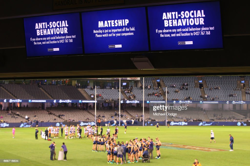Anti-social behavior warnings get broadcasted during the round four AFL match between the Carlton Blues and the Gold Coast Suns at Etihad Stadium on April 15, 2017 in Melbourne, Australia.