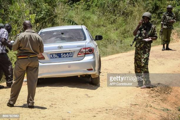 Antiterror police officers secure the car which was attacked by gunmen who killed two university employees and injured two police officers on a road...