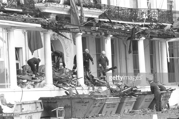 Antiterrorist squad officers sifting through the IRA bomb rubble at the Grand Hotel in Brighton Police forensic work was being hindered by the...