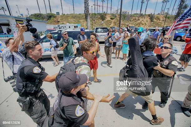 AntiTrump protesters are taken down by Police officers after scuffling with anti Sharia Law demonstrators during the March For Human rights and...