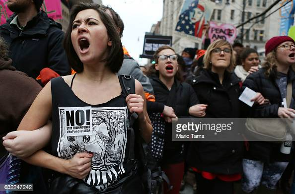 AntiTrump protesters chant during a demonstration on January 20 2017 in Washington DC Protesters attempted to block an entrance to the inauguration...