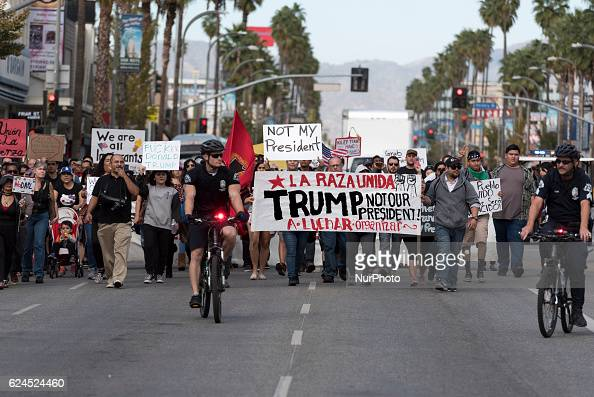 AntiTrump protesters march along Van Nuys Boulevard in Los Angeles California on November 19 2016