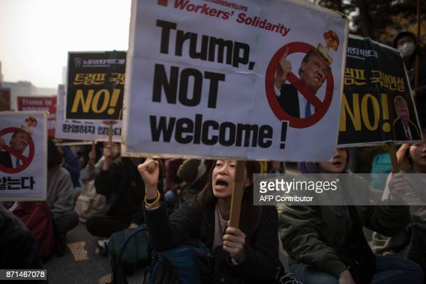 AntiTrump protesters sshout slogans during a rally outside the National Assembly in Seoul on November 8 2017 US President Donald Trump offered North...