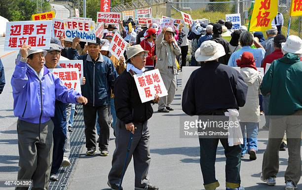 AntiUS air base relocation protesters march on in front of the Camp Schwab on March 24 2015 in Nago Okinawa Japan Okinawa Prefectuere governor...