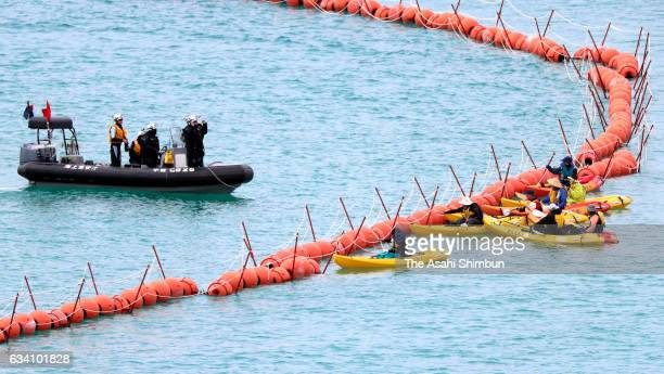AntiUS air base relocation protesters on kayaks approach to the restricted area off Henoko while Japan Coast Guard officers patrol on February 7 2017...