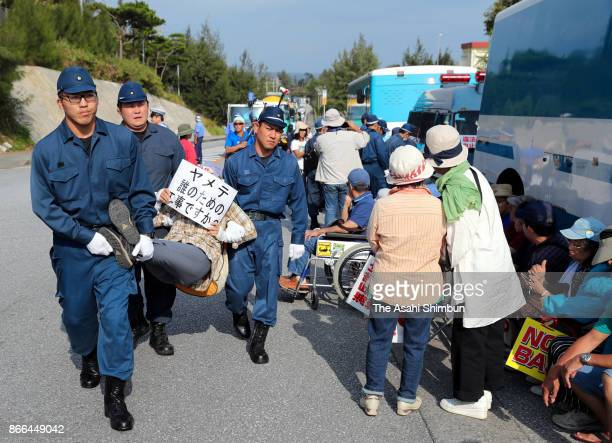 AntiUS airbase sitin protesters are forcibly removed by police officers during a rally marking the six months from the start of reclamation work off...