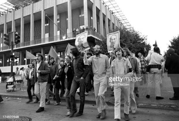 AntiVietnam War demonstrators carry posters of President of North Vietnam Ho Chi Minh as they march during a rally Berkeley California September 5...