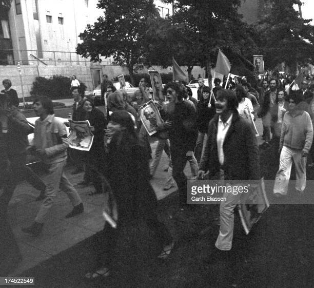 AntiVietnam War demonstrators march near Telegraph Avenue as they carry posters of President of North Vietnam Ho Chi Minh during a rally Berkeley...