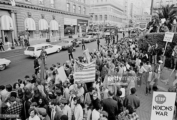 AntiVietnam War protesters stand in Union Square as they await President Nixon's arrival at the St Francis Hotel San Francisco California August 21...
