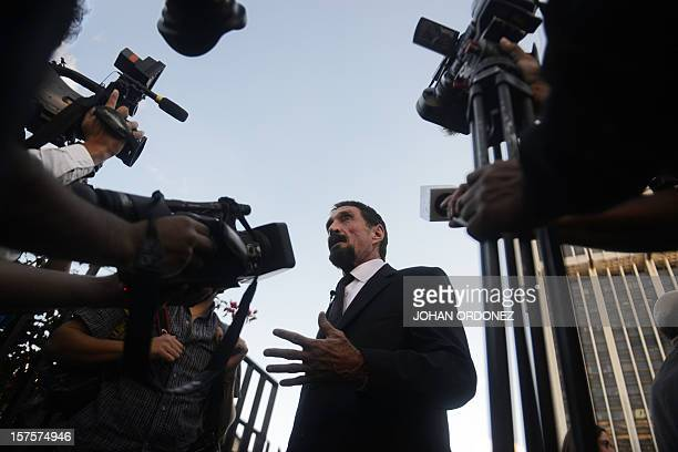 US antivirus software pioneer John McAfee answers questions from journalists in front of the Supreme Court in Guatemala City on December 04 2012...