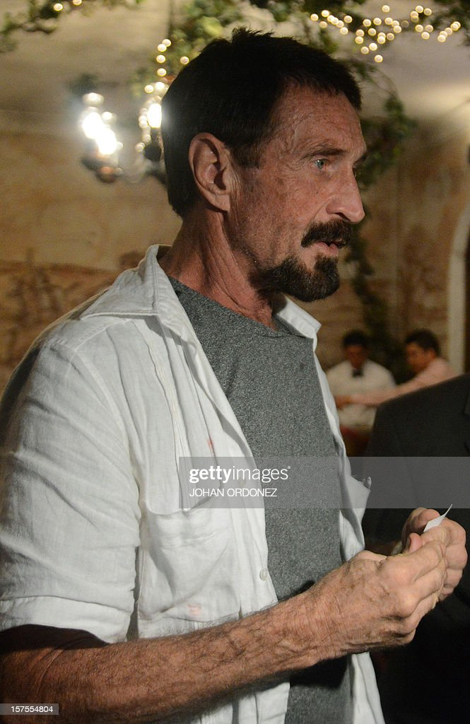 US anti-virus software pioneer John McAfee answers questions to a journalist in a restaurant in Guatemala City on December 04, 2012. McAfee, wanted for questioning over the murder of his neighbor last month in Belize, is seeking political asylum in Guatemala. AFP PHOTO / Johan ORDONEZ