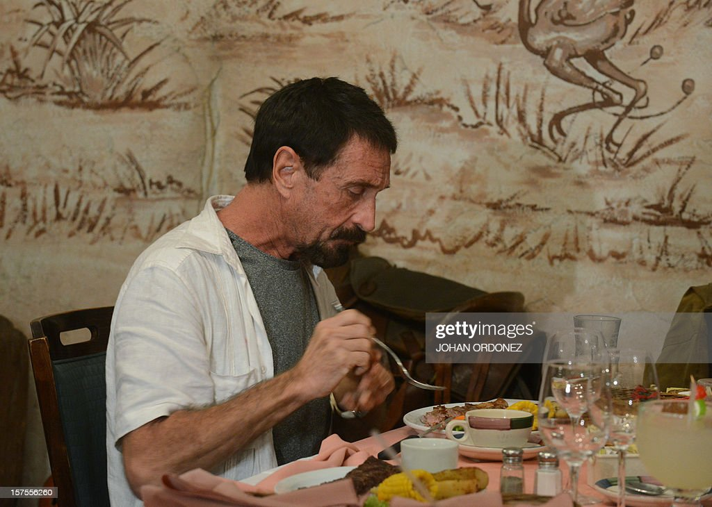 US anti-virus software pioneer John McAfee eats in a restaurant in Guatemala City on December 04, 2012. McAfee, wanted for questioning over the murder of his neighbor last month in Belize, is seeking political asylum in Guatemala. AFP PHOTO / Johan ORDONEZ