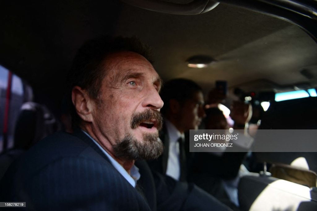US anti-virus software pioneer John McAfee gestures as he arrives at the Aurora international airport in Guatemala City on December 12, 2012. McAfee escaped immediate deportation to Belize on Wednesday as Guatemala decided to expel the American back to the United States instead. McAfee, who entered Guatemala illegally after more than three weeks on the run, is wanted in Belize for questioning over his neighbor's murder last month. AFP PHOTO/JOHAN ORDONEZ