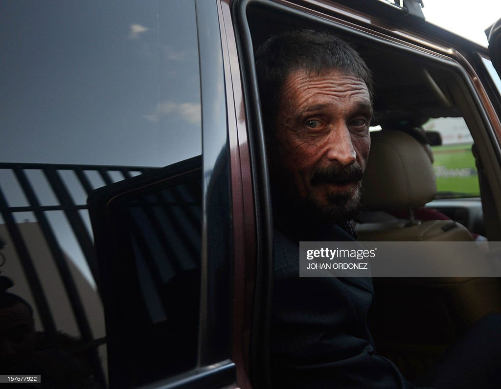 US anti-virus software pioneer John McAfee gestures while leaving, in front of the Supreme Court in Guatemala City on December 04, 2012. McAfee, wanted for questioning over the murder of his neighbor last month in Belize, is seeking political asylum in Guatemala. AFP PHOTO / Johan ORDONEZ