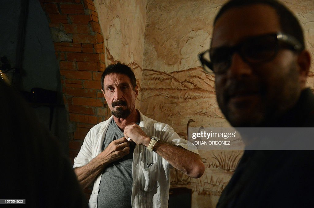 US anti-virus software pioneer John McAfee gestures while visiting a restaurant in Guatemala City on December 04, 2012. McAfee, wanted for questioning over the murder of his neighbor last month in Belize, is seeking political asylum in Guatemala. AFP PHOTO / Johan ORDONEZ
