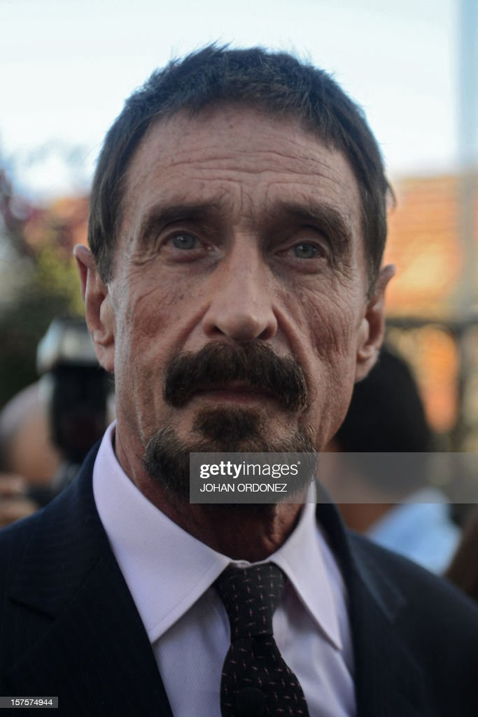 US anti-virus software pioneer John McAfee looks on in front of the Supreme Court in Guatemala City on December 04, 2012. McAfee, wanted for questioning over the murder of his neighbor last month in Belize, is seeking political asylum in Guatemala. AFP PHOTO / Johan ORDONEZ