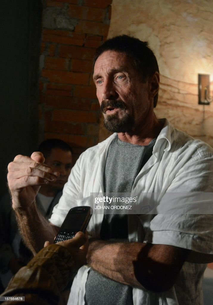 US anti-virus software pioneer John McAfee speaks with journalists in Guatemala City on December 04, 2012. McAfee, wanted for questioning over the murder of his neighbor last month in Belize, is seeking political asylum in Guatemala. AFP PHOTO / Johan ORDONEZ