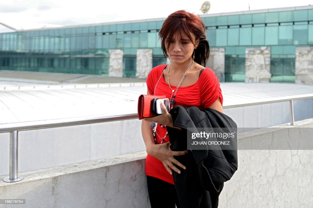 US anti-virus software pioneer John McAfee´s Belizian girlfriend, Samantha Vanegas, waits for his arrival at the Aurora international airport in Guatemala City on December 12, 2012. McAfee escaped immediate deportation to Belize on Wednesday as Guatemala decided to expel the American back to the United States instead. McAfee, who entered Guatemala illegally after more than three weeks on the run, is wanted in Belize for questioning over his neighbor's murder last month. AFP PHOTO/JOHAN ORDONEZ
