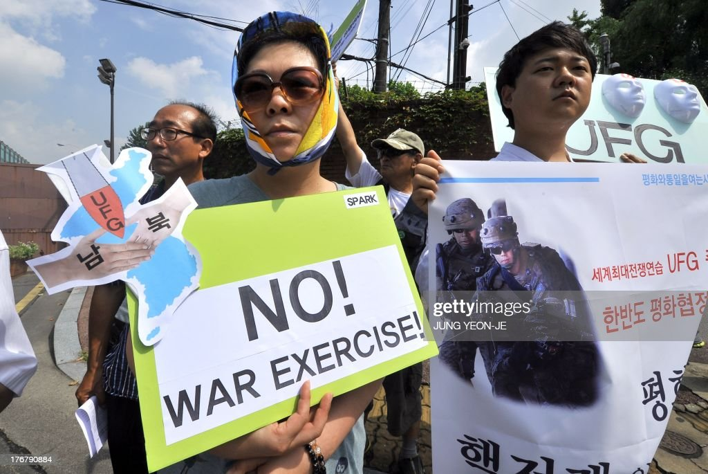 Anti-war activists hold placards during a rally against South Korea-US joint military exercise, called Ulchi Freedom Guardian, outside a US Army base in Seoul on August 19, 2013. South Korea launched a military drill on August 19 with the United States against a simulated North Korean invasion, even as tensions between Seoul and Pyongyang eased after a series of breakthroughs.