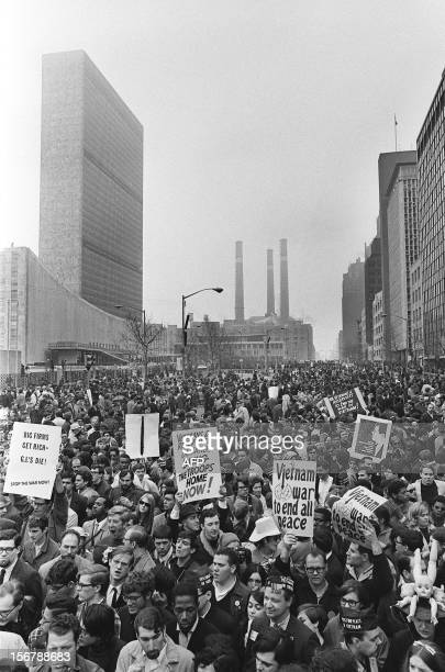 Antiwar demonstrators march outside United Nations headquarters on April 16 1967 in NewYork to protest against war in Vietnam