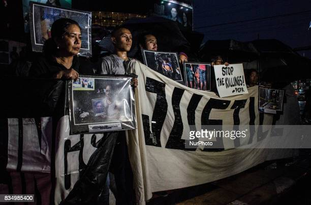 Antiwar on drugs groups hold pictures of victims of drug related extrajudicial killings on a protest in Manila Philippines on 18 August 2017 More...