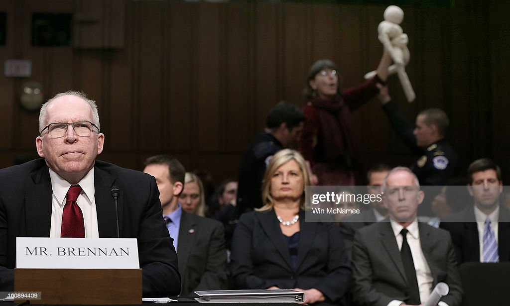Anti-war protesters disrupt the start of a nomination hearing for U.S. Assistant to the President for Homeland Security and Counterterrorism John Brennan before the Senate Intelligence Committee February 7, 2013 in Washington, DC. Brennan is the nominee to be the next Director of the Central Intelligence Agency. Brennan was expected to face sharp questioning on the U.S. military drone program in addition to questions about his nomination to head the CIA.